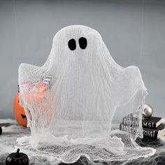 Make a cute spooky ghost with cheesecloth and school glue!