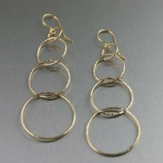 Are you looking for a distinctive pair Gold Dangle Earrings? These Quadruple Tiered Hammered Nu Gold Dangle Earrings will circle you back to chic! Your new signature basics, these gleaming earrings. Wholesale Gold Jewelry, Clean Gold Jewelry, Silver Jewelry, Silver Wedding Rings, Silver Rings, Gold Jewellery Design, Designer Jewelry, Discount Jewelry, Paper Jewelry