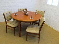 MId CENTURy DANISh STYLe EXTENDINg TEAk by TheBritishInvasion, $695.00 Susan: too modern? Good price for table and chairs...