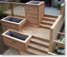 I like the different levels of this deck.  I don't know if these planter boxes are a good idea, but they're attractive.
