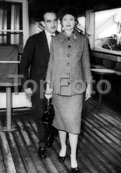 After spending a long holiday in the United States, Prince Rainier and Princess Grace (formerly Grace Kelly the actress) return home to Monaco. They are pictured leaving the SS Constitution at Cannes on the way to Monaco 19th November 1956