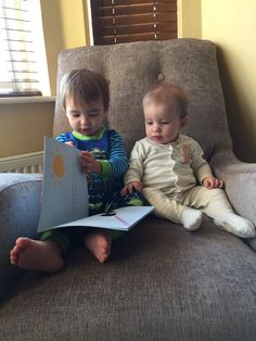 Toddler and baby reading Lilly Mae book