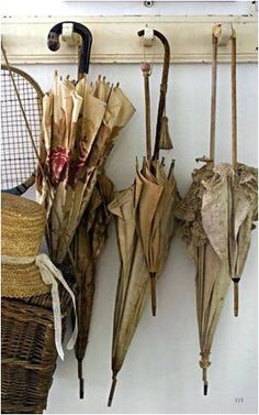 Vintage umbrellas.....hang as window treatment in craft rm. where to find some? The hunt is on!