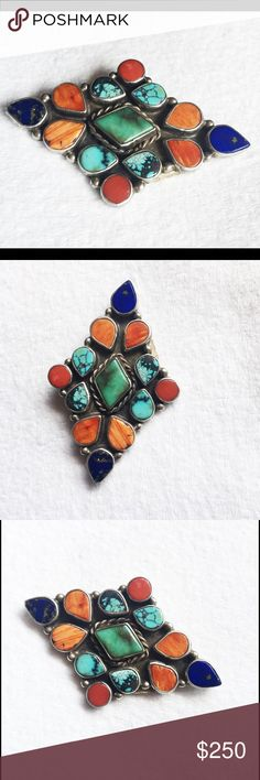 """Vintage Sterling Navajo Oscar Betz Gemstone Brooch What a lovely & rare-to-find Vintage diamond shaped sterling silver brooch (and/or pendant) that has beautiful gemstones of spiny Oyster, Coral, Lapis and Turquoise Stones.  All stones are bezel set - About 2-1/2"""" w by just over 1-1/2"""" tall - This is circa 1970's / 80's - It is marked Oscar Betz - His jewelry maintains is value and is highly collectible and its even rarer to find a brooch - This is vintage and will show surface scratches…"""