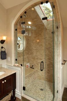 Shower stall with 2 sides glassed in, tile, bench, round window