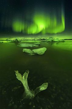 Image: Aurora Borealis above an icy landscape in Iceland, November 2013. (© David Martin Castan/Solent N/Rex Features)
