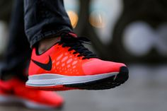 This colorway of the Nike Air Zoom Pegasus 31 is covered in Hot Lava red and is contrast with black accents.