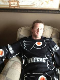 Scott Hartnell is a strange, strange man. And is taking  a nap in what he alleges is his parents' Flyers snuggie.