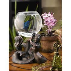 Upgrade your home decor with this beautiful mermaid fishbowl stand Fish stand flaunts three mythical beauties, gracefully intertwined Fishbowl accessory boasts built-in 3 point LED lighting system