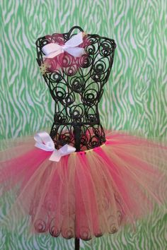 pink and yellow tutu with white bow tie