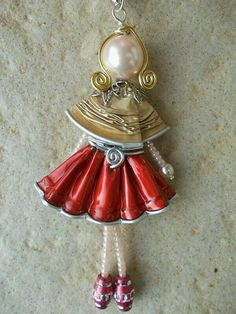 cute hand made piece -- doll.. Collana