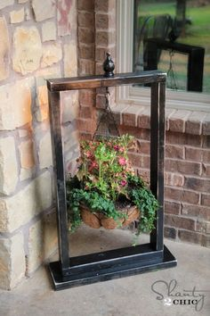 Hanging plant inside a frame...I'm thinking something for xmas