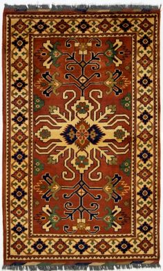 alfombra persa que está en el salón, bajo la televisión.