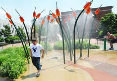 "South Oxford Park features high ""cattails"" surrounding a spray shower among its unusual play equipment. Water Playground, Park Playground, Playground Design, Poket Park, Landscape Architecture, Landscape Design, Cool Playgrounds, Spray Park, Fountain Design"