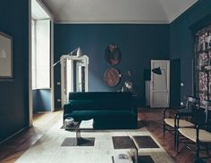 luxe: velvet fabrics, herringbone floors, dirty brass coffee tables and smooth wooden chairs. The Modern Diary