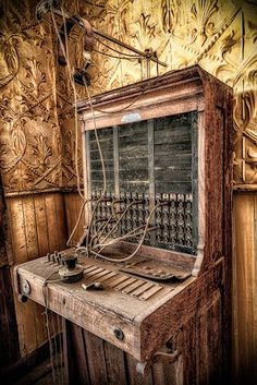 An old switchboard sits unused in an abandoned hotel in Bodie, California. If you like ghost towns Old Buildings, Abandoned Buildings, Abandoned Places, Abandoned Castles, Abandoned Property, Abandoned Mansions, Haunted Places, Haunted Hotel, Urban Exploration