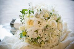 Hand tied all white bridal bouquet.