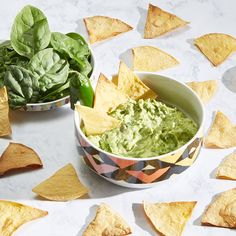 creamy spinach guacamole recipe  2 avocados 1/2 cup diced red onion 2 cloves of garlic 1 jalapeño 2 tablespoons sour cream 1 1/2 cups baby spinach 1 package corn tortillas (~10) Juice of 1/2 a lime Sea salt Pepper Avocado or olive oil Food processor (or mashing/mixing apparatus of your choice)