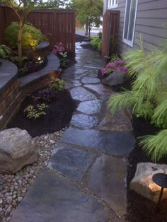 Gorgeous flagstone path with layered flower beds around