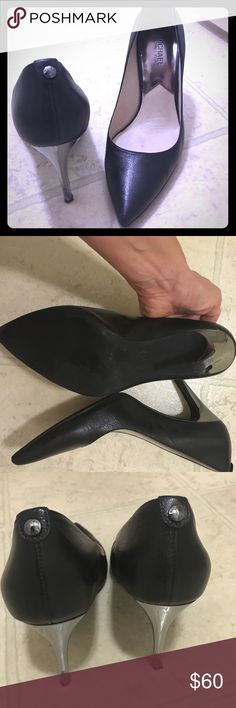 Size 8M classic black pumps Beautiful and elegant black pumps. Worn only for a few occasions. Very comfortable and sturdy Michael Kors. Size 8M, made of leather. MICHAEL Michael Kors Shoes Heels