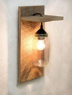 This mason jar light fixture is the perfect wall sconce for rustic, country, or western décor. Made from reclaimed barn wood, it looks great with or without the rope detail. Hang one on either side of the bed or bring a rustic touch to your living room. ROPE ACCENT OPTIONAL This