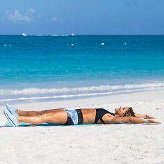STARFISH CRUNCH Sculpts sexy abs! Begin on your back with arms and legs out to the sides. In one movement, lift shoulders and legs off the ground and hug knees to chest, engaging core to come up. Slowly lower back down. Complete 15 reps.
