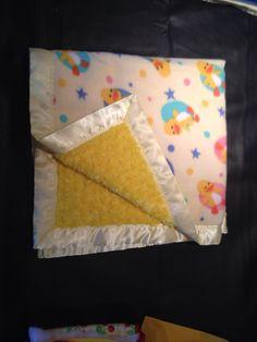Baby blanket with fleece ducks and yellow rose swirl