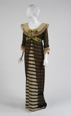 Evening dress, 1910, by Paul Poiret (French, 1879–1944).  Green and ivory striped silk, black silk chiffon, and white linen.