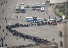 Patient: 'Queuing is a national sport for North Koreans,' says Lafforgue. This photo shows people waiting for a chance to catch the bus to work