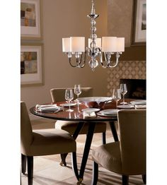 A contemporary chrome Quoizel Downtown chandelier is a perfect fit for this dining area. Chandelier Ceiling Lights, Mini Chandelier, Ceiling Fixtures, Quoizel Lighting, Transitional Chandeliers, Cozy Place, Glass Ball, Kitchen Lighting, Polished Chrome