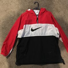 vintage 80s windbreaker has two worn spots but makes the look better because of how retro the piece is plus not very noticeable very light and stylish Nike Tops