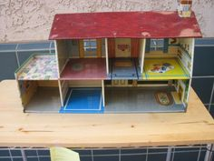 Tin dollhouse - this is like the one my Mom had when she was a little girl. She passed it on to me and I loved playing with it too @Marilyn Mills