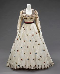 """Evening/Afternoon Ensemble, With Afternoon Bodice, Texier St. Engley: ca. 1875, French, silk. """"An air of coquettishness and youthful presence inform this set of French dress coordinates. The colorful and spritely decorative details lend a sense of whimsy. The choice of fabric and the inclusion of alternate bodices made this ensemble appropriate for both late day and evening wear."""""""