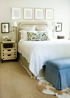 classic, neutral bedroom.  patterned lumbar + layered rugs