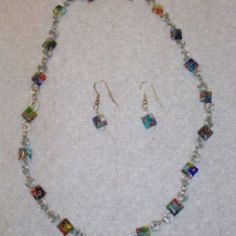 Glass beads with spiral links.  Each link was hand spiraled. popespizzaz@gmail.com