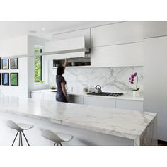 sleek contemporary kitchen, continuity of marble on island and backsplash keeps the look clean