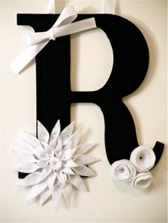 Trying to find an all season wreath for my front door, hmmmm this is a cute idea. Monogram Wreath with Handcrafted Flowers by rbirkel on Etsy, $12.99
