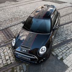 You can get bonnet or sport stripes on any MINI. Shown here, the Carbon Edition's unique stripes, in matte black with red pine striping.