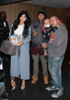 Kylie Jenner and rumoured beau Tyga take time out to deliver gifts #dailymail