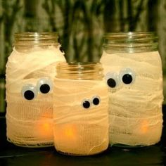 Easy DIY halloween craft Wrap jars in gauze and attach googly eyes! This will be great with the solar lids!!! Im getting out the gauze!!
