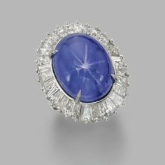 Gems and jewelry and other sparkling things. Gorgeous Star Sapphire and baguette diamond ring.