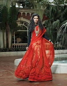 Here is a picture of Nargis Fakhri in Sabyasachi for 'Femina Bridal Looks'. She looks drop-dead gorgeous. You dig? Indian Attire, Indian Outfits, Indian Clothes, Indian Dresses, Lehenga Sari, Red Saree, Bridal Lehenga, Anarkali, Indian Fashion Designers