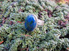 This is a malachite and azurite mix cab.....  Set in silver, size 7, #257 by Sandy River Jewelry