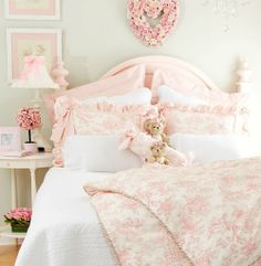Pale green walls, and hints of pink everywhere.  A sweet girls room!