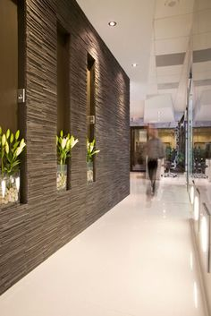 Occupying a coveted street level corner location in a high-rise office building right on Connecticut Avenue in Chevy Chase, MD gave this Prosthodonti. Zen Design, Niche Design, Modern House Design, Door Design, House Wall Design, Dental Office Decor, Dental Office Design, Office Interior Design, Interior Decorating