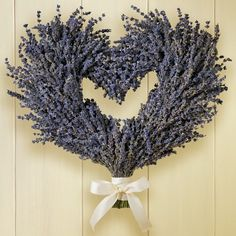 """Lavender Heart Wreath - WilliamsSonoma - This Hidcote lavender is a dwarf variety of English lavender noted for its fragrance as well as its deep-purple flowers. Ours is grown on a family Farm in California, air-dried and gathered into a heart-shaped wreath accented with cream-colored ribbon. To enjoy its lovely scent all year long, pinch off the blooms and tuck them into drawers. All herbs are grown without pesticides or herbicides. 16"""" x 13"""". $49.95"""