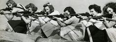 Mundelein College students participating in the popular extracurricular club, the College Rifle Team. 1942