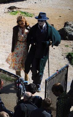 Johnny Depp + some actress on the set of Dark Shadows. I am in LOVE with her dress!!