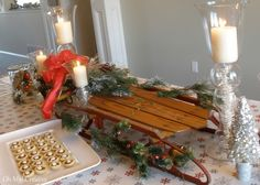 vintage sled tablescape centerpiece, home decor, seasonal holiday decor, woodworking projects, Flexible Flyer Sled greens gilded pine cones and a bow make this a pretty holiday centerpiece Christmas Sled, Rustic Christmas, Christmas Holidays, Christmas Crafts, Christmas Ideas, Christmas Parties, Holiday Centerpieces, Christmas Tablescapes, Christmas Decorations