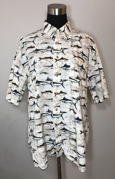 """100% cotton. Beige with black boats and blue, green and orange fish. One left chest pocket. Box pleat in back center. Very nice casual button down shirt for a cruise or tropical vacation! Shoulder width 23"""" (58cm). 